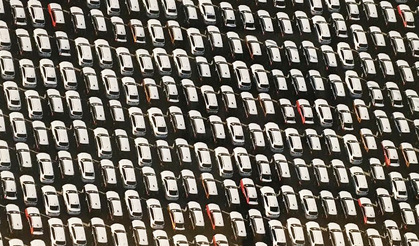 """J. Henry Fair, """"New Cars Queued for Loading onto Transport Ship"""" (detail)"""